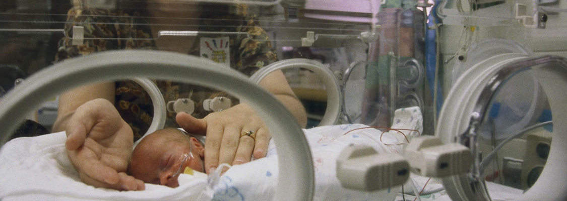 nicu-nurse-with-preemie-incubator-banner