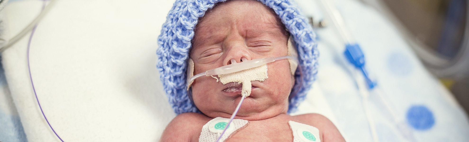preemie-in-the-nicu-with-blue-cap